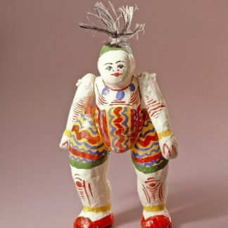 Art object of person with painted colorful wavy lines and stripes, red shoes, and hair sticking up high above head.