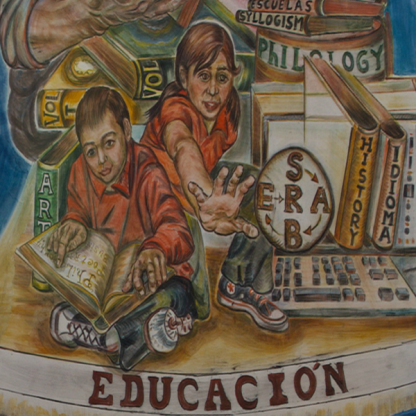 Educacion painted mural with two children. One reading, one reaching forward. Surrounded by books and computer keyboard.