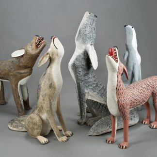 Coyote and fox figurines looking up and howling.