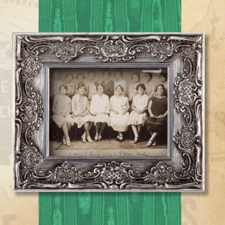 Framed old black and white photograph of group of women seated in dresses.