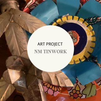 Art Project: NM Tinwork.Large blue metal flower with Crush soda cap in center. Golden metal leaf shapes.