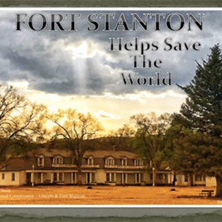 Fort Stanton Helps Save the World. Fort buildings, trees, and cloudy sky with sun poking through.
