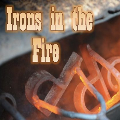 Irons in the Fire. Metal P-shaped objects and blacksmith tool glowing hot.