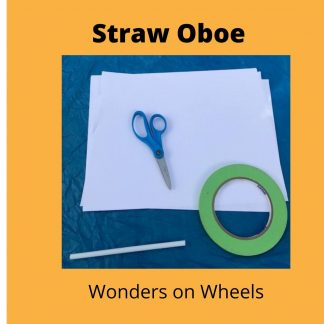 a pair of blue scissors, a roll of green tape, and a soda straw sit on top of a sheet of white paper.